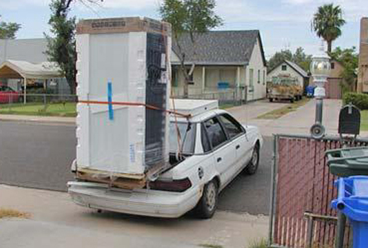 Overloaded Car with Freezer