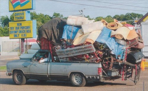 Overloaded pickup, Nacogdoches, TX. Photo by Joe Higgins