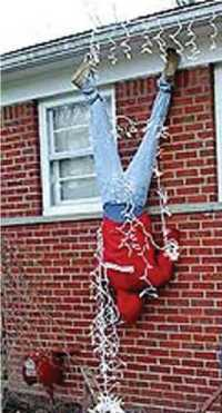 Do it yourself Humor - The danger of hanging Christmas lights on ...